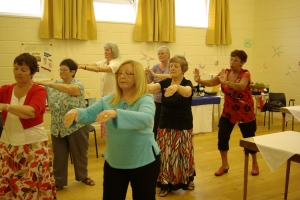 A Tai Chi demonstration at High Five's recent Afternoon Tea